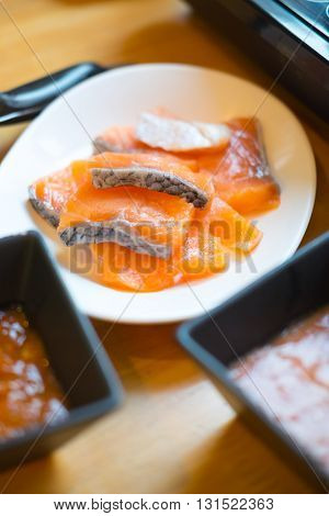 Fresh raw slice salmon on dish for cook