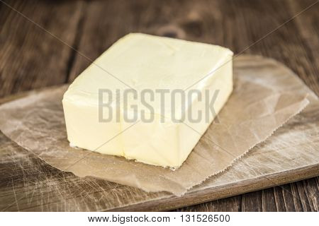 Piece Of Butter On Wooden Background (selective Focus)
