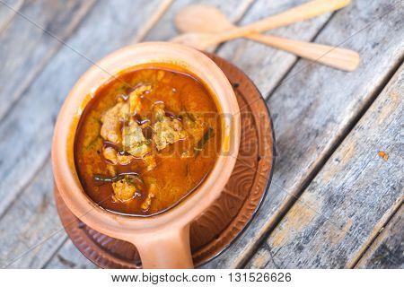 Thai panang pork curry on wood table