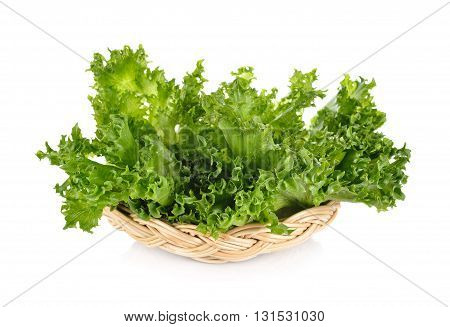 green frillies iceberg lettuce in rattan basket on white background