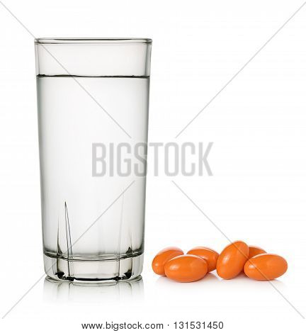 Glass of water and Rice bran oil on white background