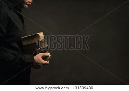 Man holding old Book in his Hands