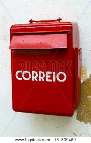 mailbox typical Portuguese post in Obidos Portugal striking for its intense red