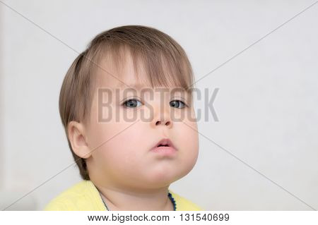 Baby Girl Portrait With Full Cheeks
