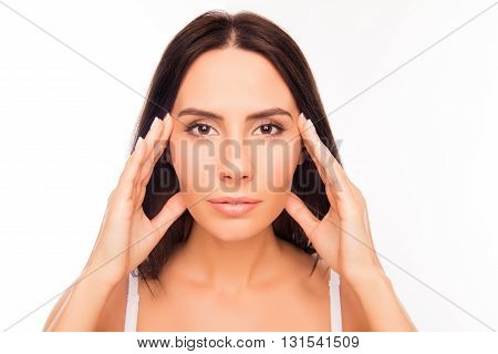 Portrait Of Sensitive Woman With Healthy Skin Touching Face
