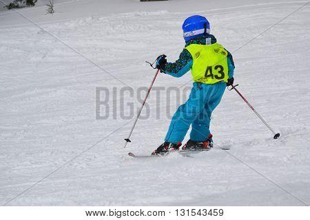 Child skiing - snowy landscape Hochficht in the Bohemian Forest