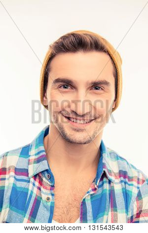 Handsome cheerful cheeky man with hat  on a white background