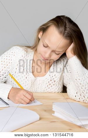 Schoolgirl Doing Difficult Homework
