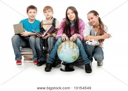 Educational theme: group of emotional teenagers sitting  together on books.