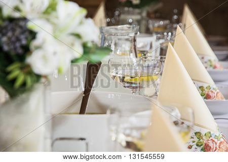 Glasses of vermouth with lemon and decorative napkins on the table. Birthday party. Refreshments theme. Alcoholic drink.