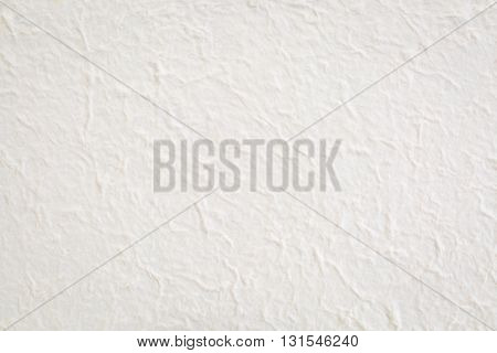 Nepalese natural lokta paper background. Nepalese Lokta Paper is a strong, durable and eco-friendly paper handmade from the fiber of the Nepal Paper Plant, also called the Daphne Shrub or Lokta Bush.