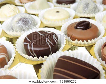 Chocolates box with chocolate truffles. Studio shot