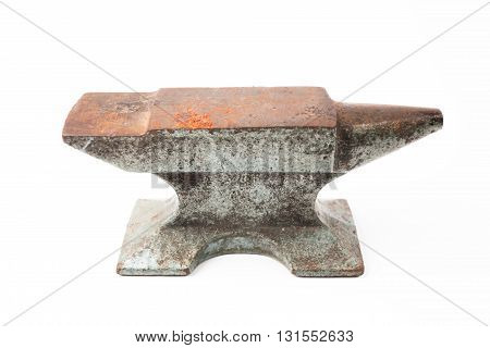 Old rusty rugged anvil foundry isolated white background.