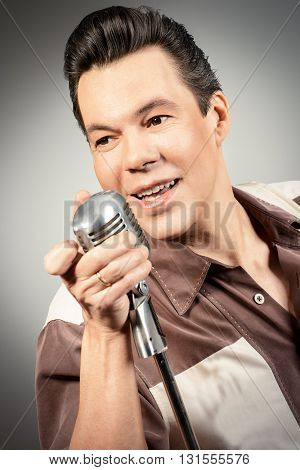Handsome male singer, who plays in the style of the sixties. Rock'n'roll, jazz man. Nostalgia.