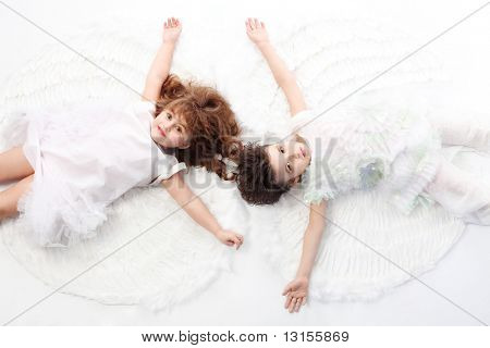 Beautiful little angels. Isolated over white background.