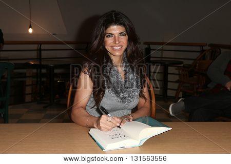 NEW YORK-FEB 16: TV personality Teresa Giudice signs copies of her book,