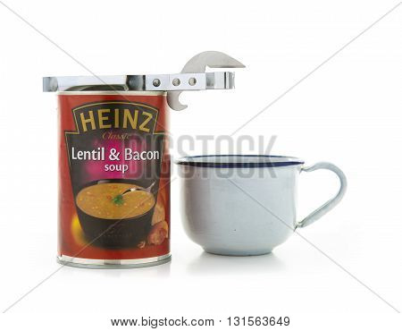 SWINDON UK - MAY 22 2016: Heinz lentil and Bacon soup with a tin opener and cup on a white background