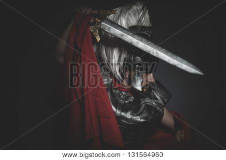 Power, Praetorian Roman legionary and red cloak, armor and sword in war attitude