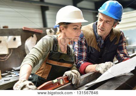 Engineers working in metallurgy warehouse