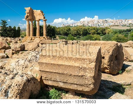 Two big columns in the Valley of the Temples of Agrigento; the temple of Dioscuri in the background