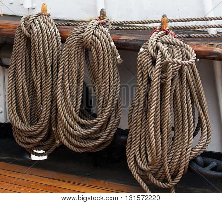 coils of rope hanging on the gunwale of an old sailing ship