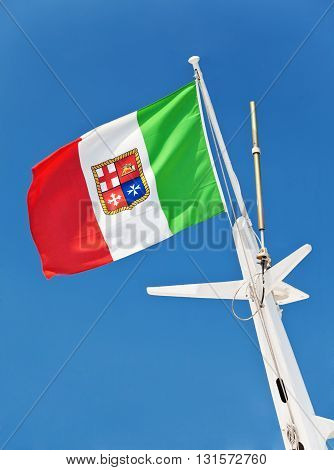 Italian flag with coat of arms of savoy dynasty with three crosses and winged lion