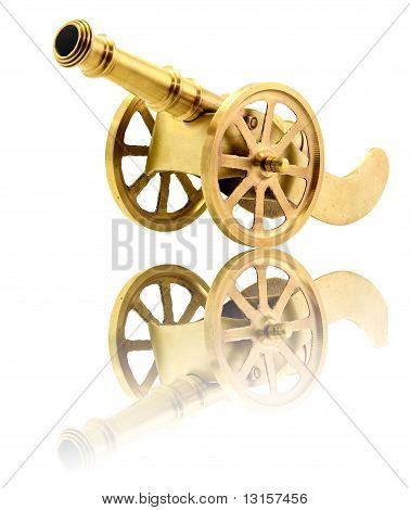 Isolated Golden Canon On White With Its Reflection