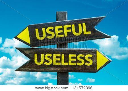 Useful - Useless crossroad with sky background