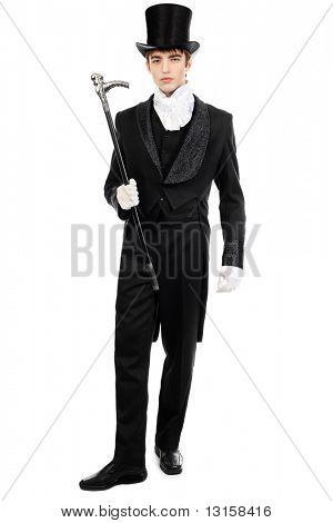 Portrait of a young gentlemen wearing dinner jacket and black top hat. Shot in a studio.