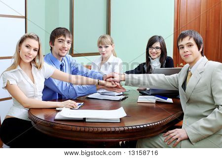 Group of business people interacting together at the office with a success.