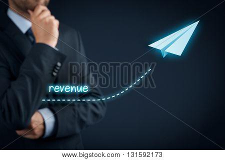 Increase revenue concept. Businessman plan revenue acceleration and growth.