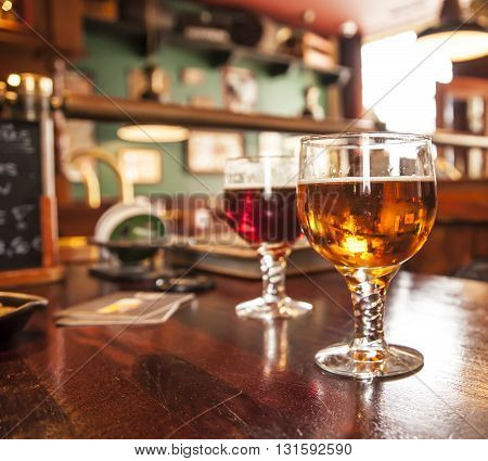 Two glasses of draught beer a red and a amber beer