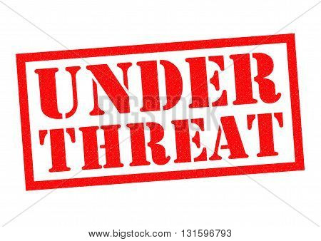 UNDER THREAT red Rubber Stamp over a white background.