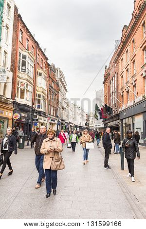 DUBLIN IRELAND - 07 MAY 2016: People walking on the Grafton Street. The main shopping street in the city is one of the most expensive in the world.