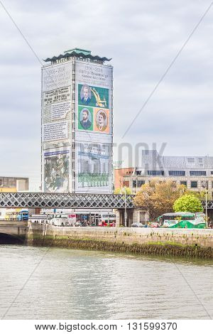 DUBLIN, IRELAND - 06 MAY, 2016: Liberty Hall building and the Liffey river. It's one of the tallest Irish buildings and the headquarters of the Services, Industrial, Professional, and Technical Union.