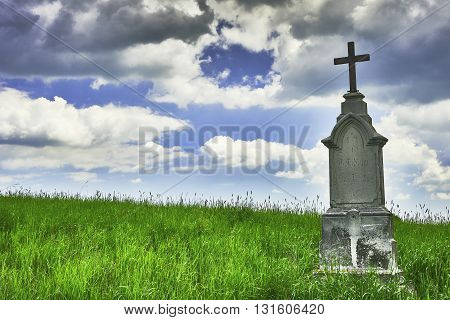 View wayside cross with spring grass with sky background
