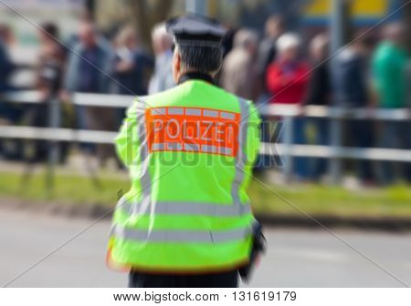german police officer stands on a street