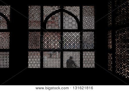 Patterned stone screen window of old Indian palace in Fatehpur Sikri Uttar Pradesh India.