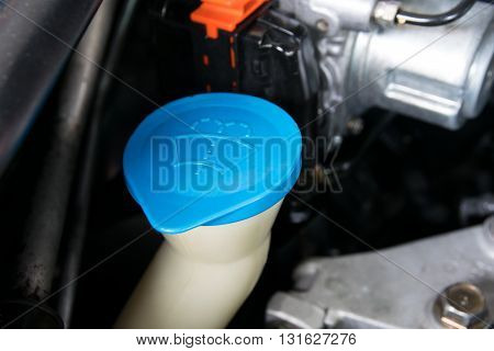 the liquid cap in car engine. antifreeze, auto, automobile, bottle