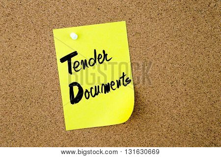 Business Acronym TD Tender Documents written on yellow paper note pinned on cork board with white thumbtack copy space available poster