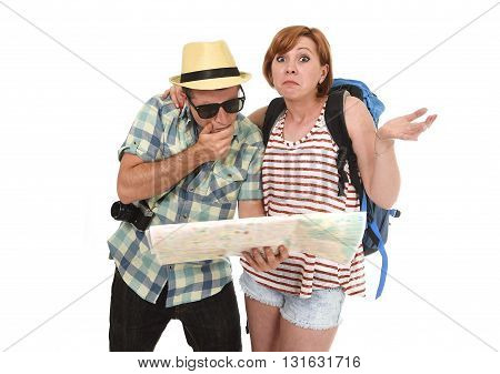 young tourist couple reading city map looking lost and confused loosing orientation with girl carrying travel backpack and man in frustrated face expression isolated white background poster