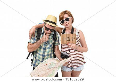young tourist couple reading city map looking lost and confused loosing orientation with girl carrying travel backpack and man in frustrated face expression asking for help isolated in white