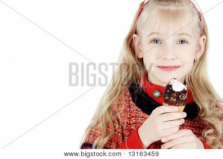 Little girl is eating chocolate ice-cream. Isolated over white background.