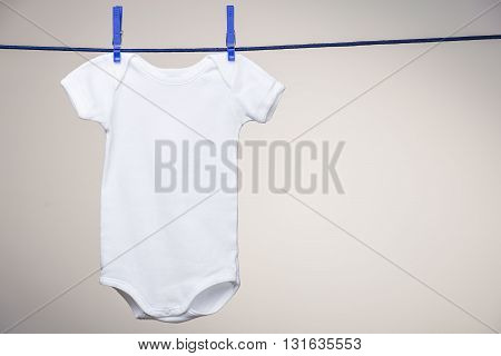 Baby Bodysuit On Clothesline