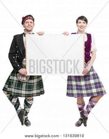 Pair Of Dancers Of Scottish Dance With Empty Banner