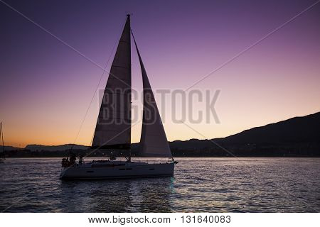 Sailing boat in the sea during twilight.