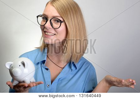 Young Pretty Woman With Piggy Bank