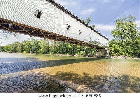 Built in 1861 the Jackson Bridge crosses Sugar Creek in rural Parke County Indiana and is the longest single span covered bridge in the state.