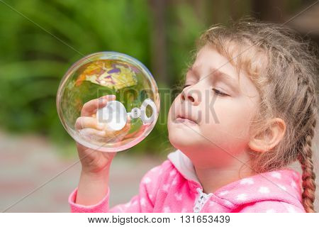 Five-year Girl Inflates A Large Circular Bubble