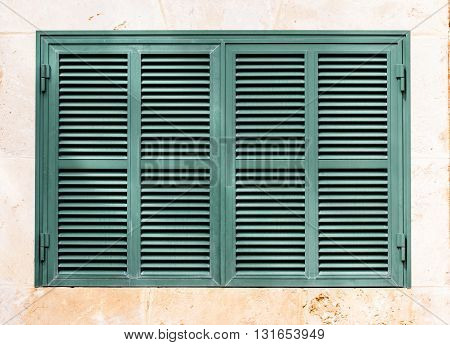 the green shutter on white background on the dun